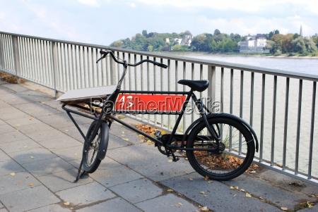 cargo bike on the riverbank