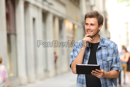 man with a tablet thinking in