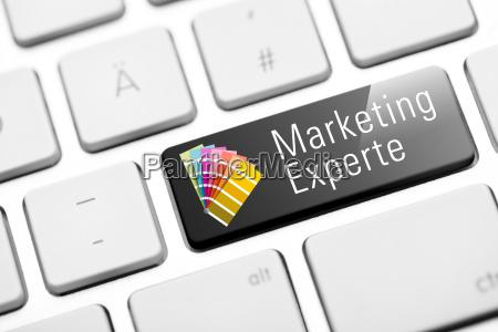 marketing expert button on white keyboard