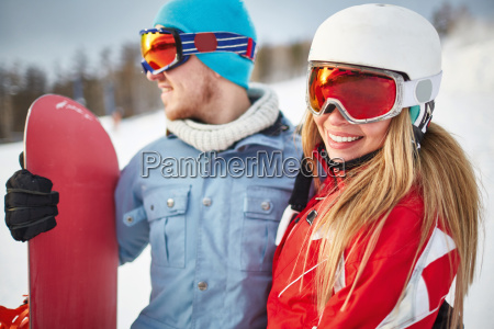 pretty snowboarder with boyfriend