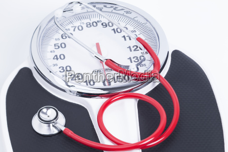 weighing scales and stethoscope