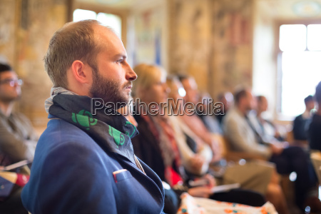 entrepreneur in audience at business conference