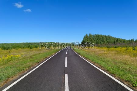 rural asphalt road with markings that