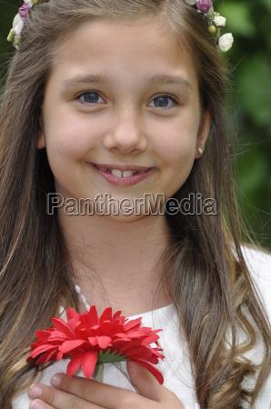 girl before communion festively dressed in