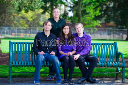 four young multiethnic friends together at