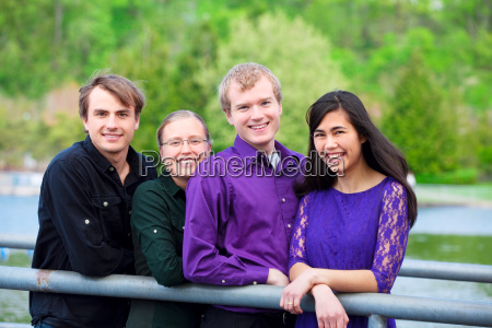 four young multiethnic friends together outdoors