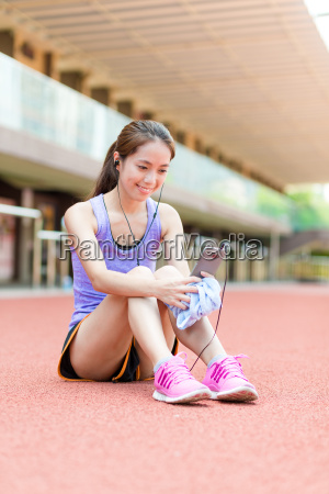 sporty woman listen to music and
