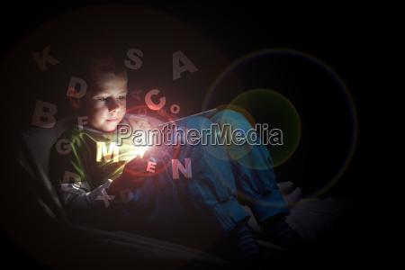 boy using tablet pc