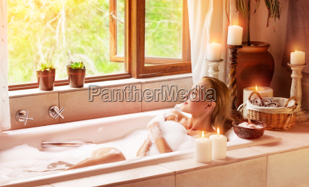 woman bathing with pleasure
