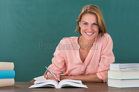 female teacher studying at desk