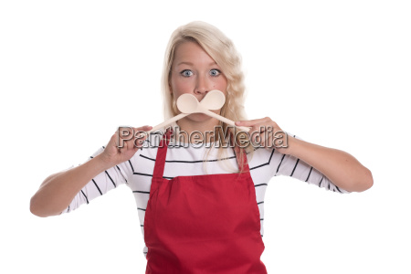 housewife in apron holding up wooden
