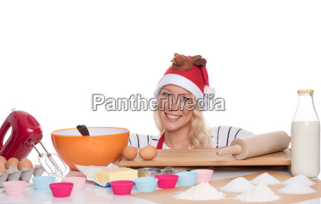bakes muffins woman with santa hat