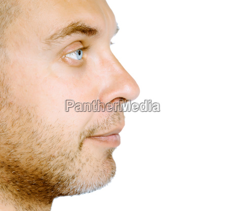 unshaven blue eyed man in profile