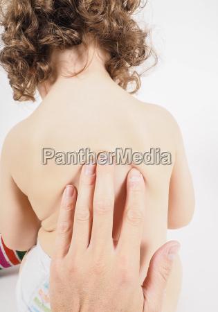 pediatrician having health check on unrecognizable