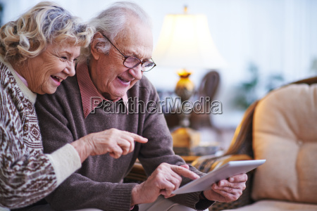 seniors with digital tablet