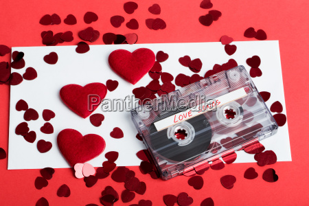 audio cassette tape on red background