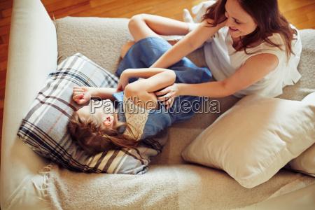 playing on sofa