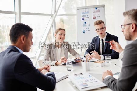 colleagues having meeting