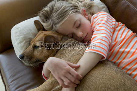 young girl and her dog cuddling