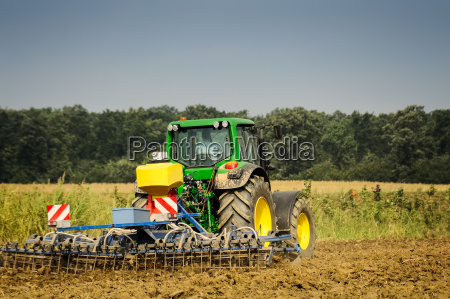 farmer with tractor at work