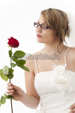 young bride with a red rose