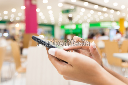 closeup hand using smart phone in