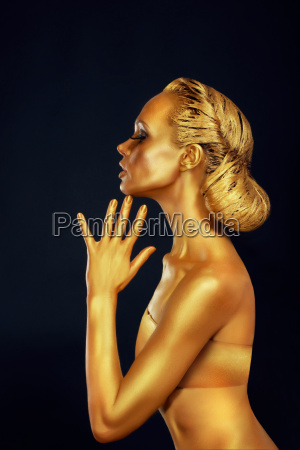 woman with golden body over black