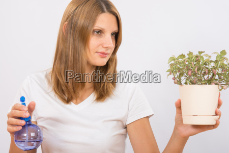 she considers the potted plants before
