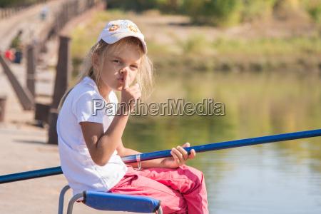 girl fishing calls for silence