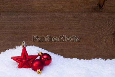 wooden christmas background on snow red