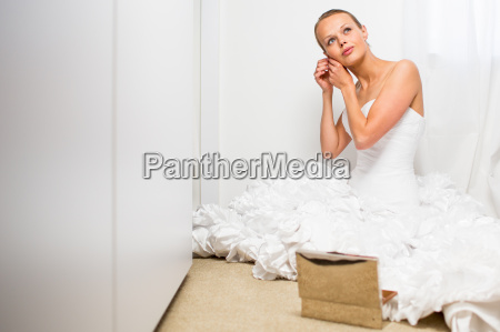 beautiful bride getting ready for her