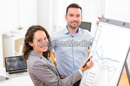 business man and woman analysing stats