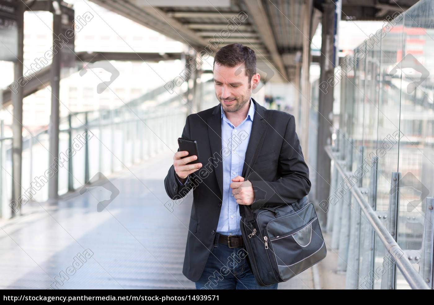 young, attractive, business, man, using, smartphone - 14939571