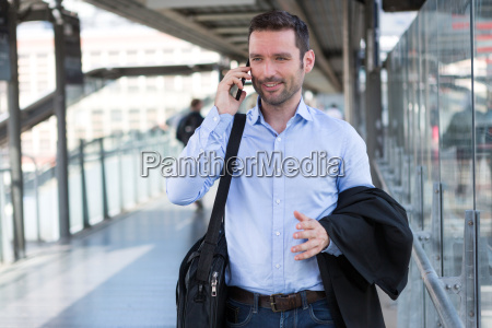 young, attractive, business, man, using, smartphone - 14939597