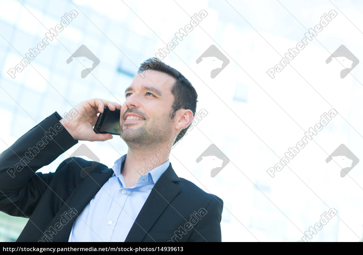 young, attractive, business, man, using, smartphone - 14939613