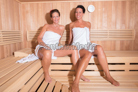two, attractive, women, in, the, sauna - 14940727