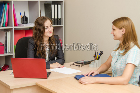 two young girls in the office
