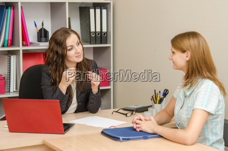 the manager listens attentively to a