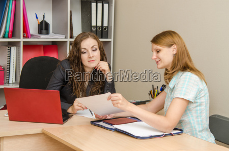 two employees of office read the