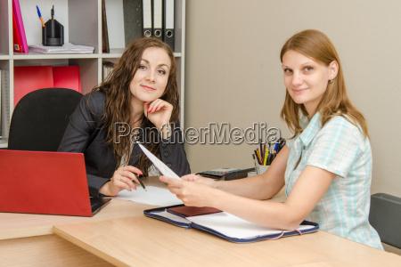 girl shows resume employer