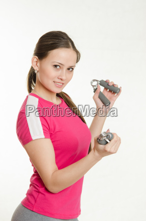 sportswoman with two expanders in the