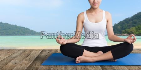 women meditation yoga on wood balcony