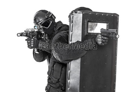 swat officers with ballistic shield