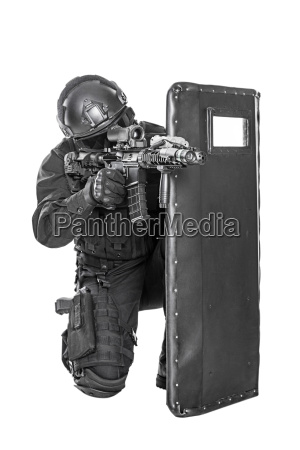 swat officer with ballistic shield