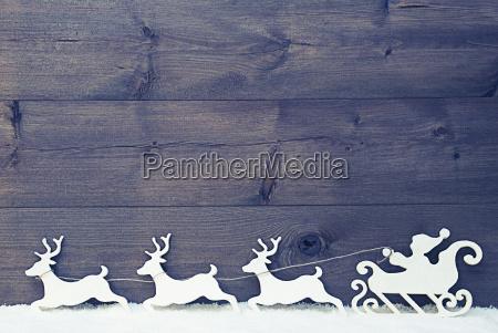 white vintage santa claus sled reindeer