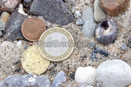 coins stones and shells in the