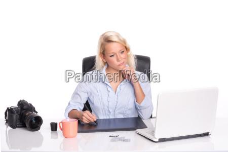 graphic edit photos on a laptop