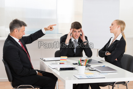 businessman arguing with his two co