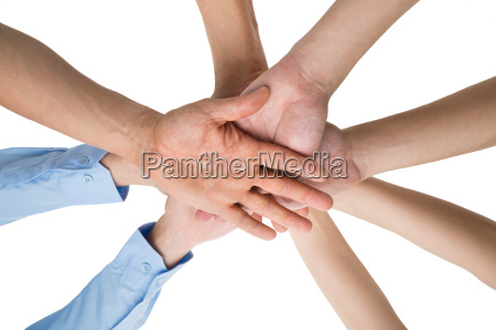 people hands stacking together