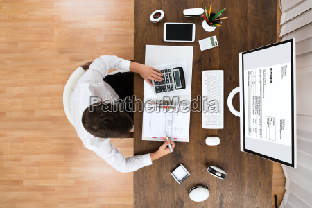 male accountant checking invoice
